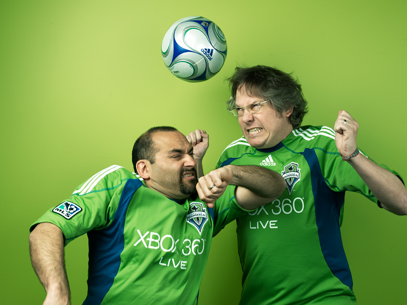 Cal and Ian of the Wexley School For Girls going up for a header in Sounders FC uniforms.  Photo by John Keatley