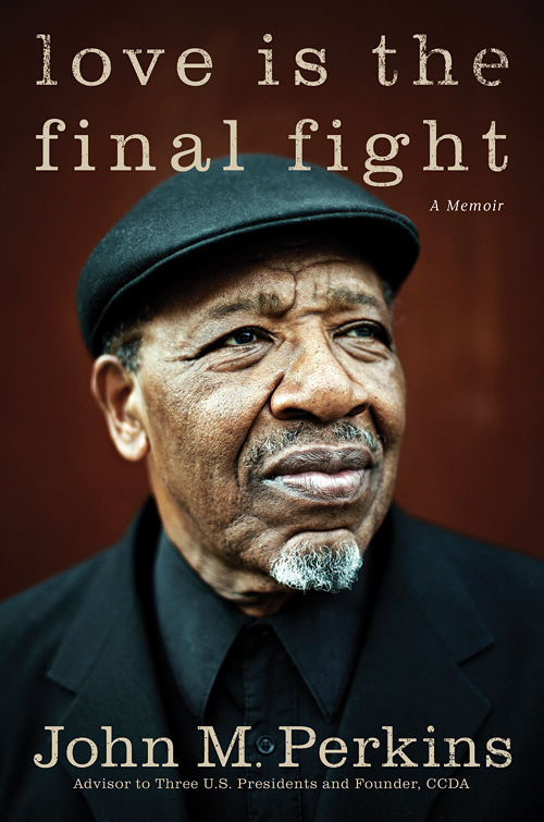The book cover of Love Is The Final Fight by John Perkins.  Photo by John Keatley.
