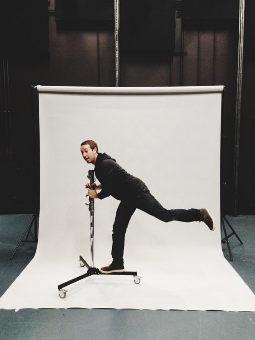 John Keatley rolling on a light stand at a photo shoot.