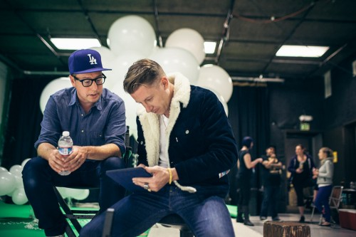 Keatley and Macklemore reviewing images.
